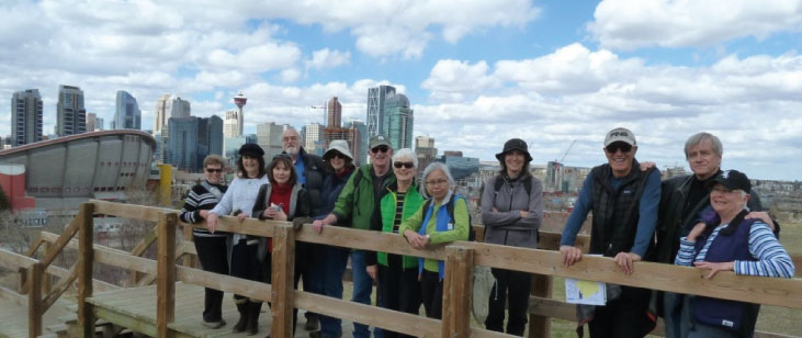 An Urban Walking group uses the source book Calgary's Best Hikes and Walks, by Lori Beattie, to plan their in-town adventures.