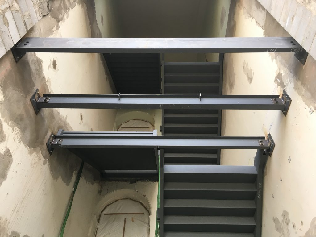 First the steel columns and stringers, platforms and threads for our new concrete stairs were installed. Then steelwork began on the new facade portions of this entrance, signalling how contemporary architecture will be sutured between the historic fabric of brick and sandstone.