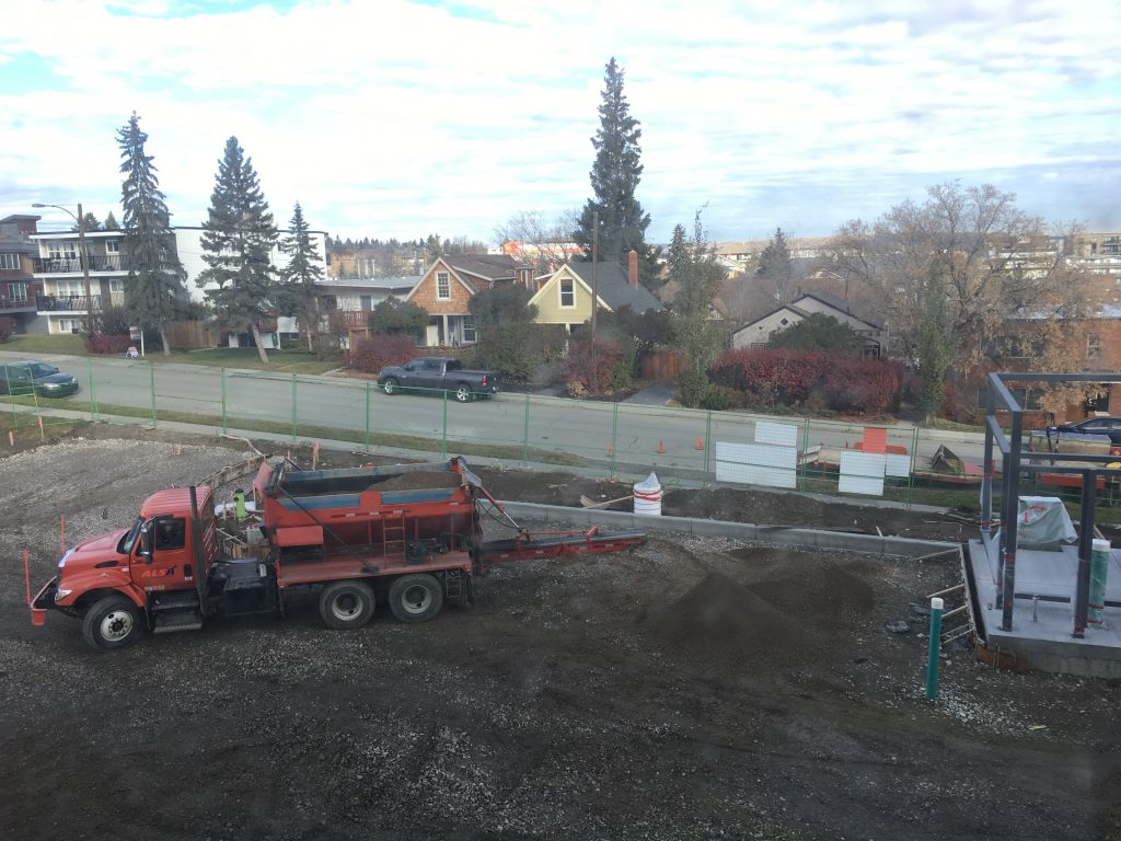Concrete curbs were added around the perimeter of our parking areas and grading began in preparation of laying gravel and asphalt ahead.
